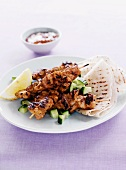 Grilled chicken tikka skewers with flat bread