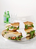 Sandwiches with shrimp, capers, aioli and watercress
