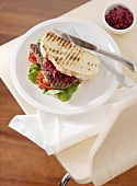 Steak sandwich with red beets and tomatoes
