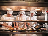 Chefs preparing food in kitchen