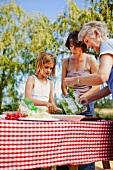 Multi generation family making picnic