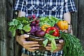 Man holding basket of vegetables