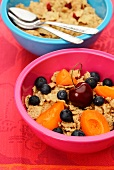 Cornflakes with fresh fruit in colourful bowls
