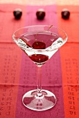 A martini with cherries