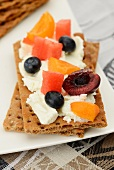 Fresh fruit and cream cheese on crisp bread