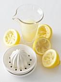 Juicer, Juiced Lemons and a Pitcher of Fresh Squeezed Lemon Juice