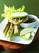Apple Slices with Peanut Butter and Pumpkin Seeds; Celery with Peanut Butter; Apple Wedges