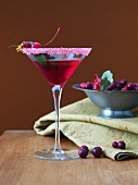 Cosmopolitan Cocktail with Cranberries and Sugared Rim