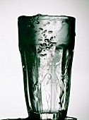 An overflowing glass of water