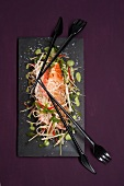 Salmon fillet wrapped in miw noodles on green apple curry (Asia)