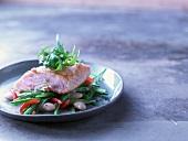 Salmon with panko flour on a bean salad