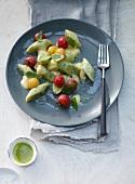 Basil gnocchi with cherry tomatoes and taleggio