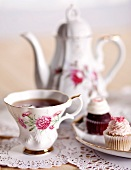 Pretty Antique Tea Cup with Mini Cupcakes and Tea Pot