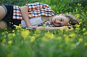 A girl lying in a field of flowers