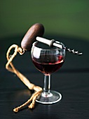 Glass of Pinot Noir with a Corkscrew