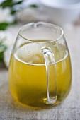 Green tea in a small glass jug
