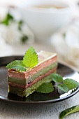 An individual raspberry and matcha cream layer cake