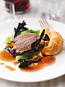 Braised beef with dried mushrooms and potato cakes
