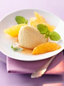 Lemon mousse with orange caramel and mint leaves