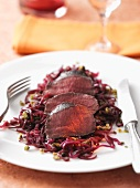 Venison fillet on a red cabbage medley with pistachios