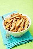 A bowl of roasted parsnip sticks