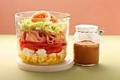 Layered salad with sheep's cheese and turkey slices