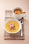 Sauerkraut soup with apple and pumpkin soup with chicken breast