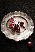 Cherries on a zinc plate
