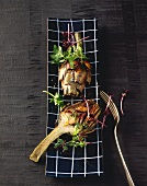 Barbecued artichokes with parsley vinaigrette and sprouts