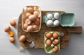 Brown and white eggs in an egg carton