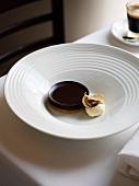 Chocolate tart with a scoop of vanilla ice cream