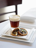 Mushroom consomme with foam and a mushroom tartlet