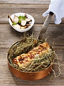 Pork fillet in hay with sour potatoes