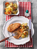 Veal escalope with a coconut coating and potato and carrot salad