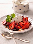 Cream cheese dumpling on strawberries with balsamic vinegar