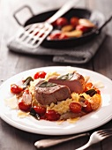 Veal medallions with sage and cherry tomatoes