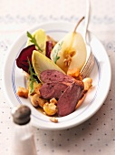 Winter salad with pears, mushrooms and venison fillet