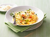 Spaghetti aglio olio with Parmesan and chilli rings