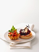 A vegetable tartlet and a cherry tartlet