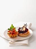 A vegetable tartlet and a cherry tartlet