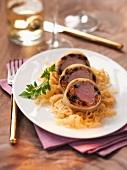 Cochon de lait roulade on a bed of sauerkraut