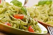 Tagliatelle with pesto, fresh basil and tomatoes
