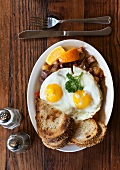 Fried Eggs, Sunny-side Up, with Homefries and Toast