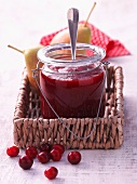 A jar of cranberry and pear jam