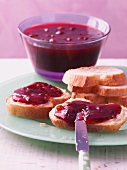Damson and red wine jam on baguette bread