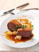 Venison steak with an almond crust with pears