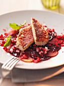 Red mullet fillets on beetroot and turnip carpaccio