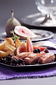 Duck breast with roast potatoes, figs and berry compote