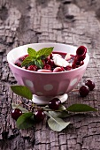 Cherry soup with pasta, sour cream and peppermint