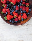 Mixed Berries in a Wooden Bowl; From Above
